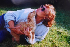 Margie with pup. She frequented the pound, looking for pups to save. She always had at least two dogs–often it was more like four.